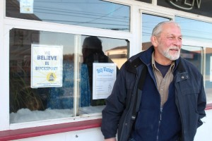 Larry Wahl stands outside his Main Street ice cream shop. PHOTO BY CHARLES EICHACKER